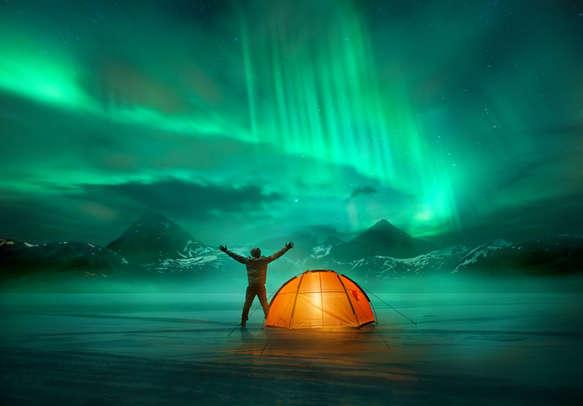 A man campingin wild northern mountains