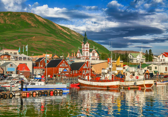 Beautiful view of the historic town of Husavik with traditional colorful houses