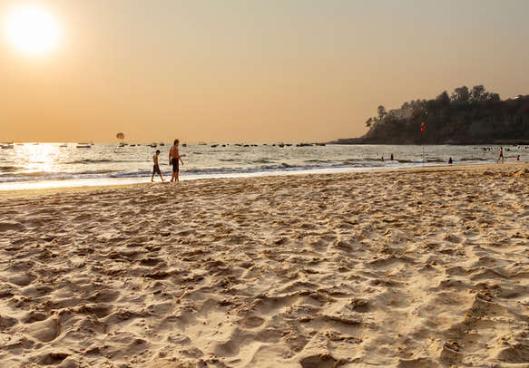 Relax by the palm-fringed sandy shore of Baga Beach