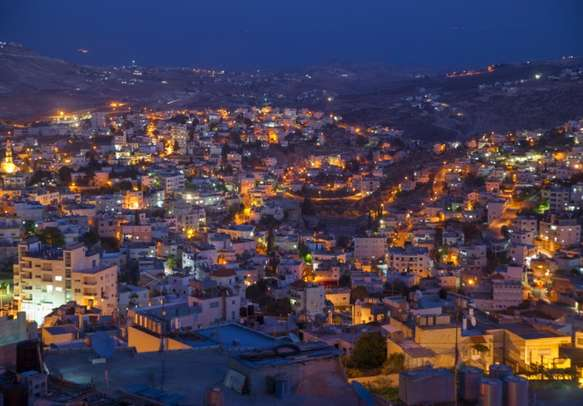 View on cozy district of Bethlehem with street lights in summer evening