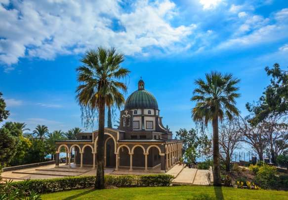 Beautiful park of cypress and palm trees in Mount of Beatitudes