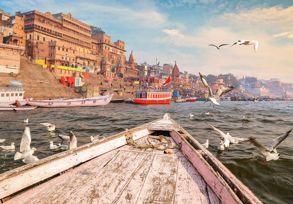 Historic Varanasi city architecture with Ganges river ghat at sunset