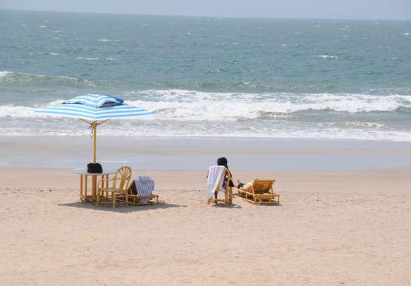 Tourists enjoy and relax at tropical Tarkarli beach, Malvan