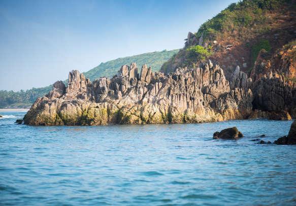 Golden rocks at Nivti beach, Nivati Malvan