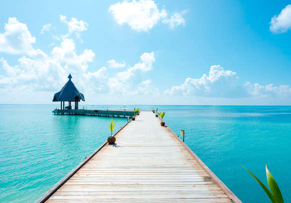 Get mesmerized by the stunning view of calm sea and clear blue sky in the Maldives