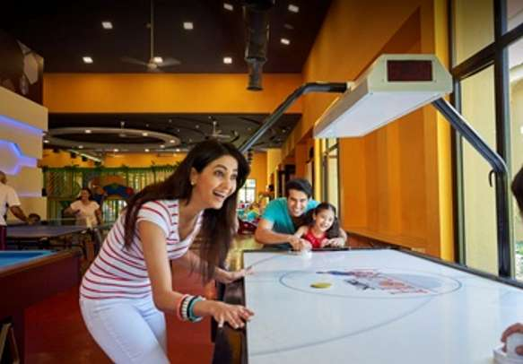 In-house entertainment with an indoor gaming arena