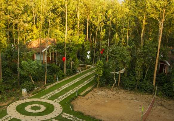 Outdoor and indoor play arenas amidst the woods