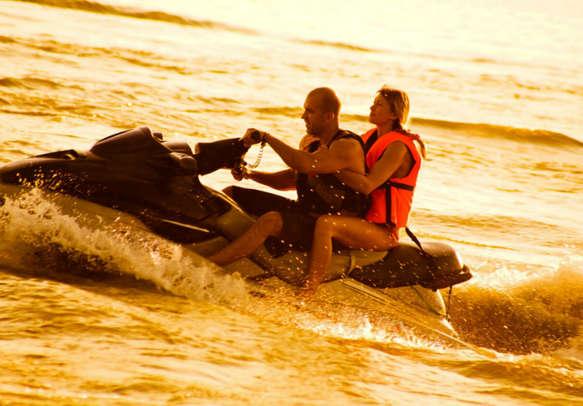 Couple enjoying water sports activities in Sri lanka