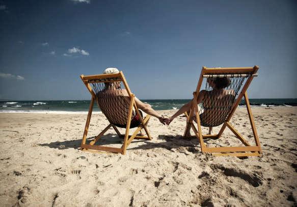 Couple relaxing at the Bentota Beach in Sri Lanka