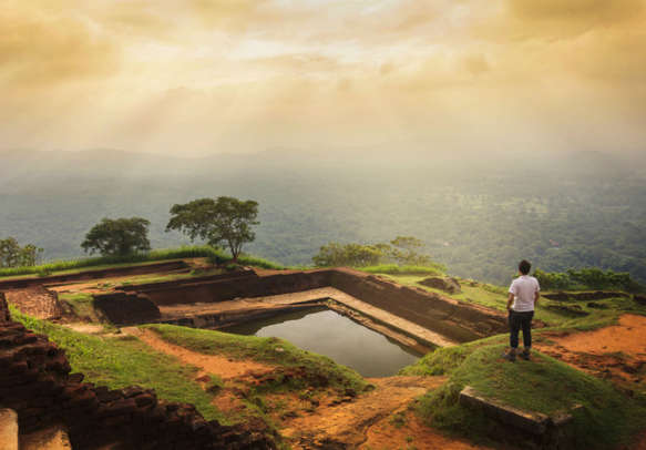 Admire scenic views of the city from the ancient Sigiriya Rock Fortress