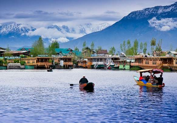 A beautiful view of the Dal Lake with houseboats and Shikaras