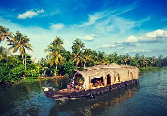 Cruise along the Kerala backwaters atop a houseboat