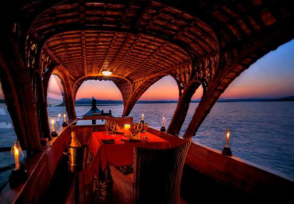 Have a grand dinner filled with romance atop a houseboat in Kerala