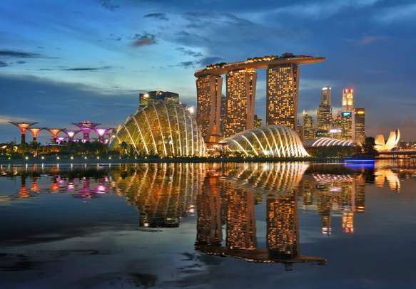 Watch the charm of the city evolve after sunset with your tour package to Singapore