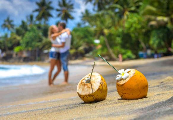 Couple enjoying their honeymoon on the Bentota Beach