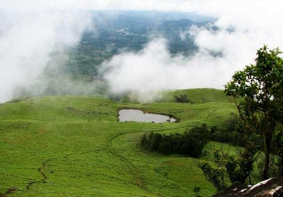 Heart shaped lake atop Chembra Peak in Wayanad