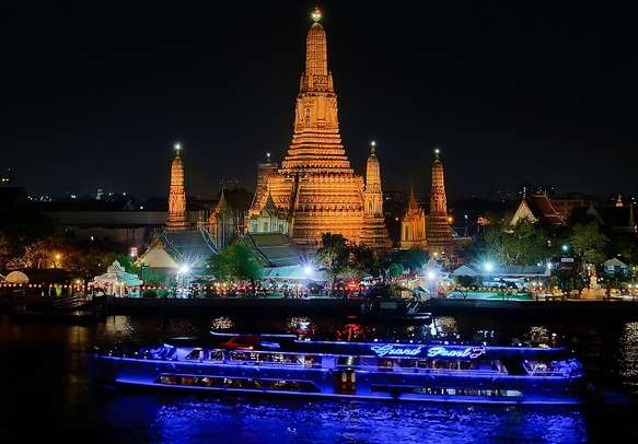 Wat Arun and cruise ship at night in Bangkok