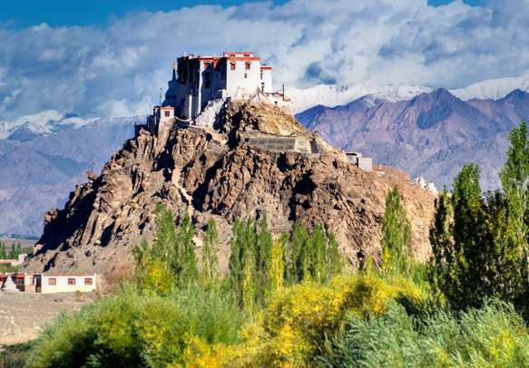 Stakna monastery with view of Himalayan mountians