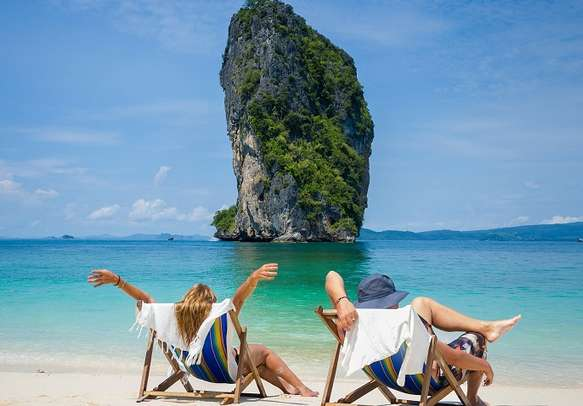 A couple rests at one of the beaches in Krabi