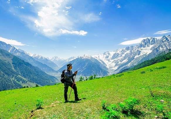 A tourist takes a hike to Sonamarg