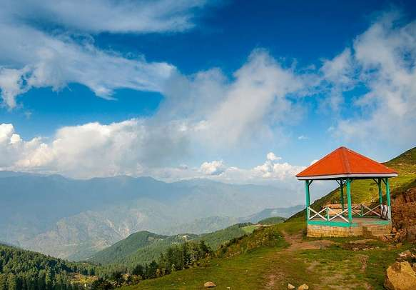 A view of the many mountains from the lush green valley of Patnitop