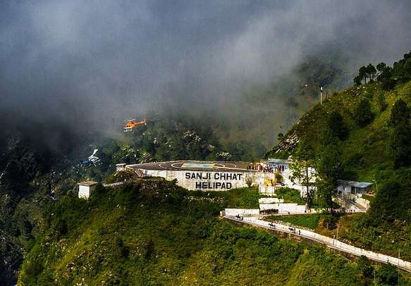 Two Helicopters flying very close at the helipad nead Vaishno Devi