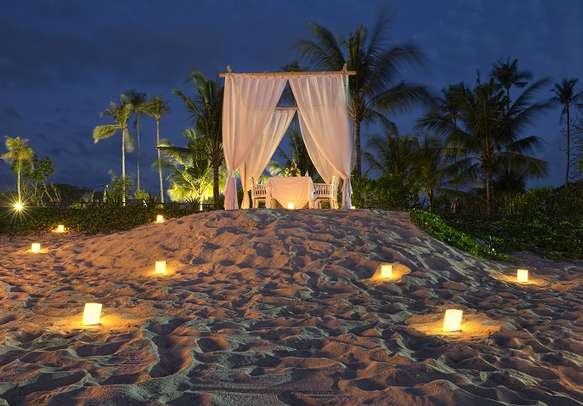 Mesmerizing romantic dinner setting on a beach in Bali.