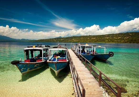 Glass-bottomed boats docked in Bali.