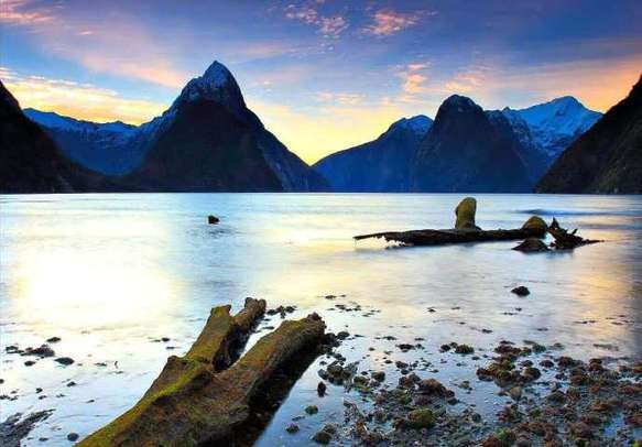 Enjoy grand sunsets at Milford Sound on this trip to New Zealand.