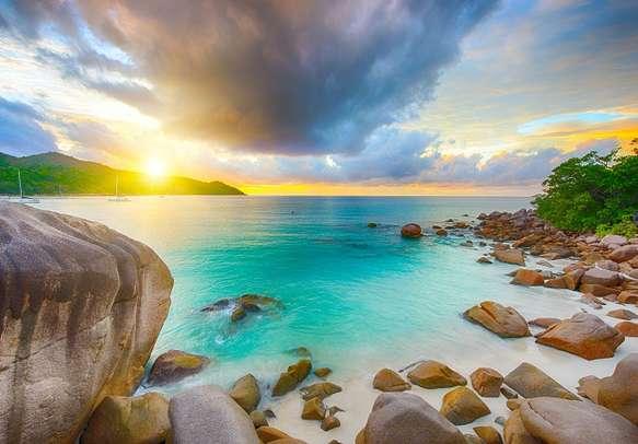 Beautiful sunset over the famous beach Anse Lazio in Praslin island.