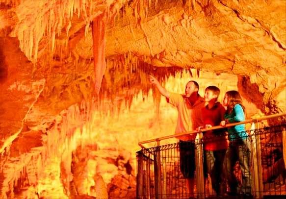 Tourists enjoying a boat tour of Waitomo Caves