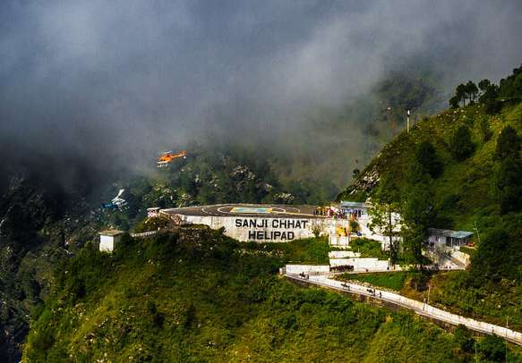Two Helicopters flying very close at the helipad nead Vaishno Devi.