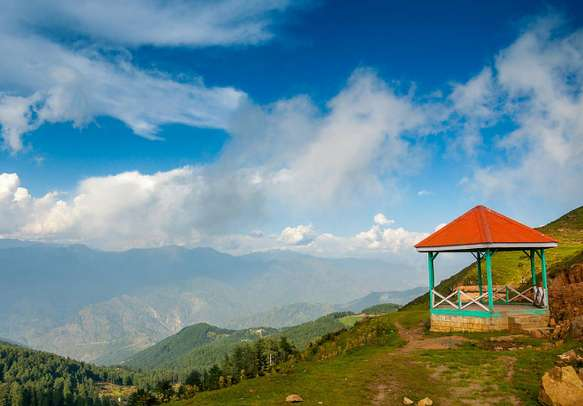 A view of the many mountains from the lush green valley of Patnitop.