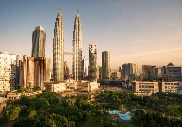 Marvel at the famous Petronas Twin Towers in Kuala Lumpur