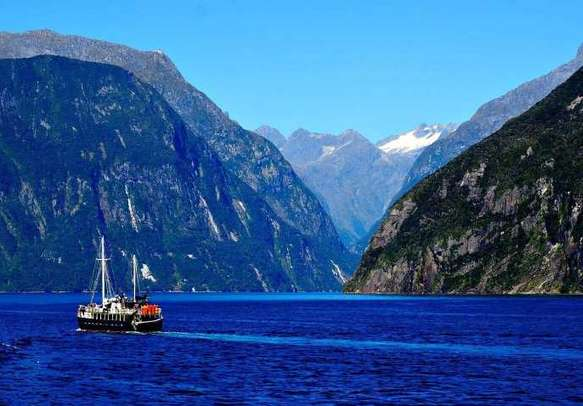 Explore the scenic lakes and mountains of Milford Sound.