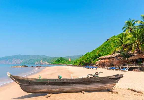 People enjoying their beach vacation in Goa.