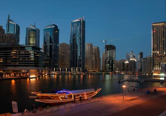 Experience an intermix of delicious food, dance, and traditional music at Dhow Cruise
