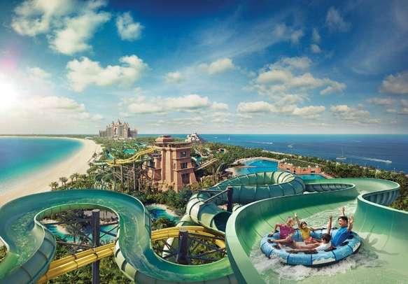 Enjoy a fun filled adventure at Aquaventure Waterpark on this Dubai honeymoon tour.