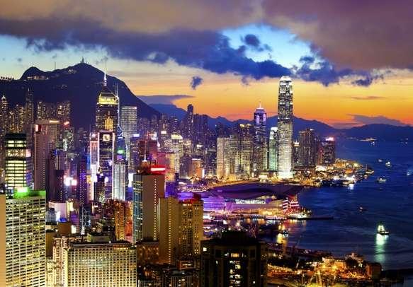 Enjoy the shimmering views of the Hong Kong skyline at night.