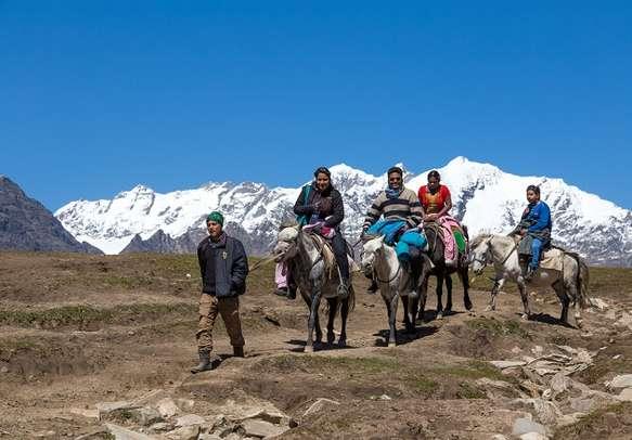 Tourists enjoying horse riding near Rohtang Pass.