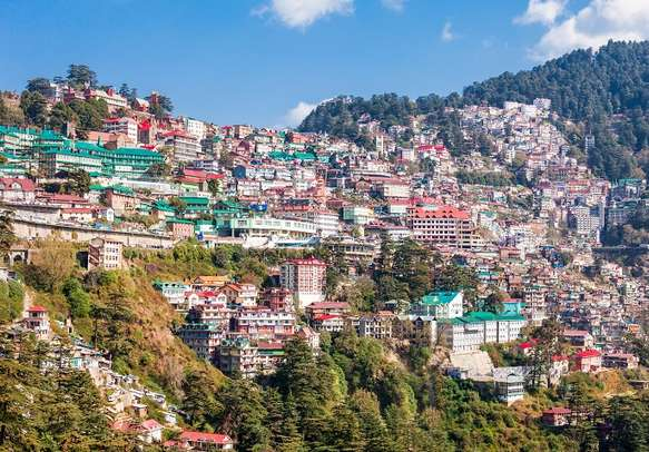 Houses stacked neatly on hills in Shimla Hill Station of Himachal