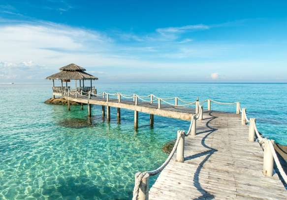 Explore the beauty of Thailand aboard this wooden pier.