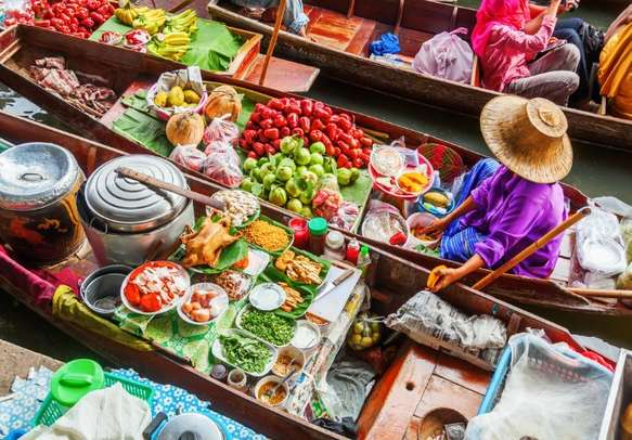 Immerse yourself in the colorful vibrance of the floating market in Bangkok.