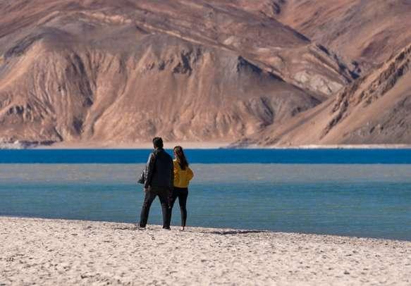 Couple at Pangong Lake in Leh Ladakh.