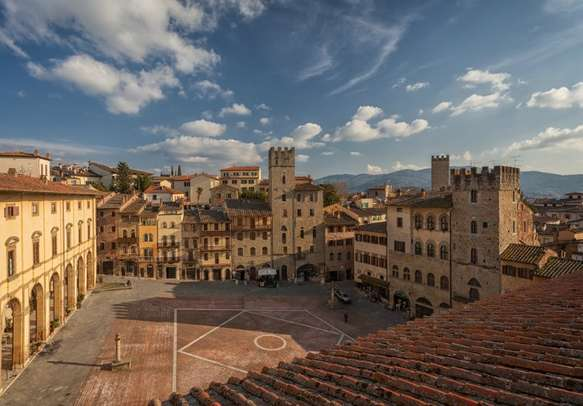Enjoy a view from the bell tower of the Church of Santa Maria della Pieve, Arezzo, Italy