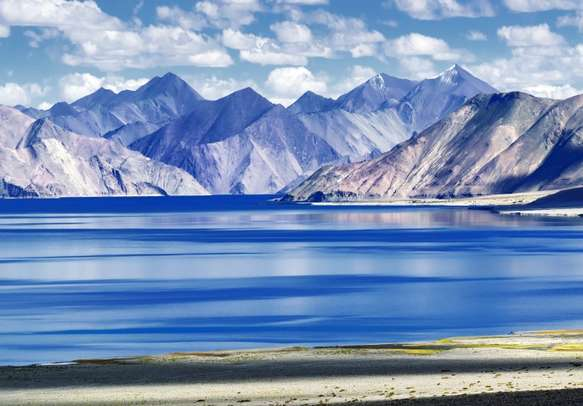 The mountains in the backdrop of Pangong Tso lake offer a surreal view