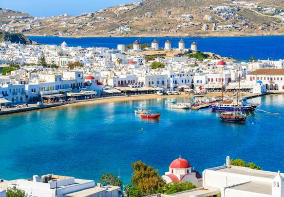 The Mykonos port dotted with boats