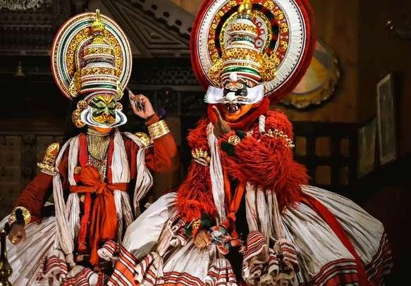 Enjoy a fun Kathakali performance on this Kerala tour holiday.
