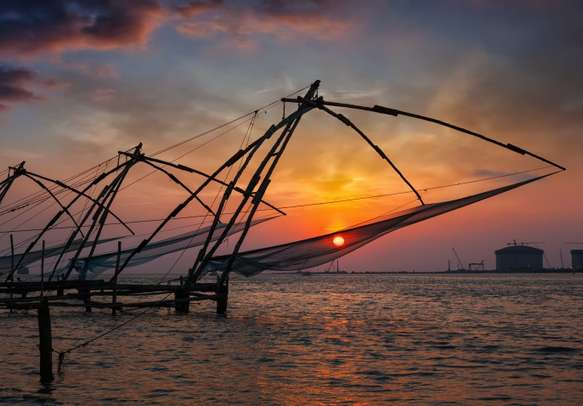 Chinese fishnets during sunset in Kochi