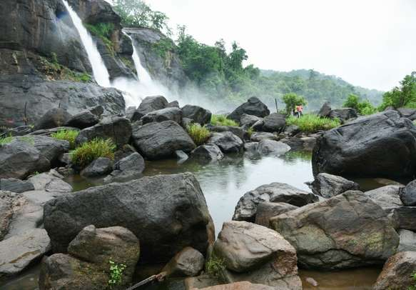 Enjoy the mesmerizing view of the Athirapally waterfalls.